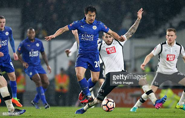 Shinji Okazaki of Leicester City in action with Bradley Johnson of Derby County during the Emirates FA Cup Fourth Round tie between Derby County and...