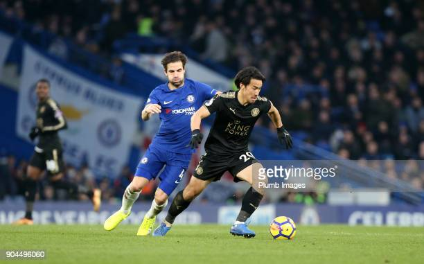 Shinji Okazaki of Leicester City in action with Cesc Fabregas of Chelsea during the Premier League match between Chelsea and Leicester City at...