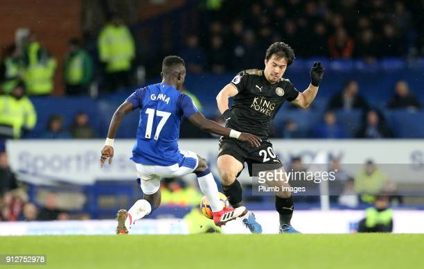 Shinji Okazaki of Leicester City in action with Idrissa Gana Gueye of Everton during the Premier League match between Everton and Leicester City at...