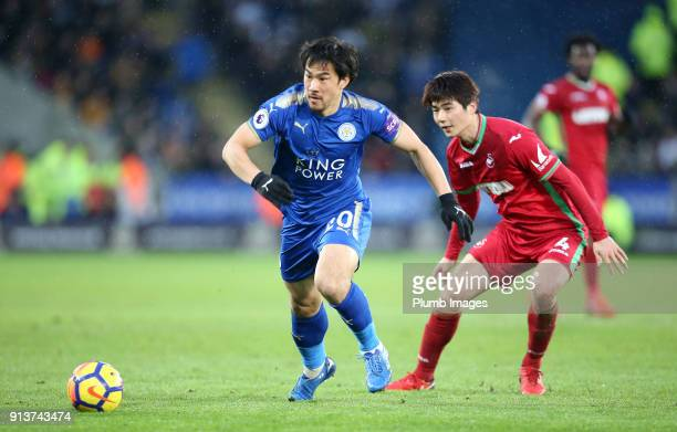 Shinji Okazaki of Leicester City in action with Ki SungYueng of Swansea City during the Premier League match between Leicester City and Swansea City...