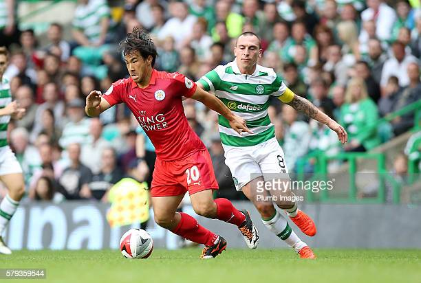 Shinji Okazaki of Leicester City in action with Scott Brown of Celtic during the ICC Cup match between Celtic and Leicester City at Celtic Park...