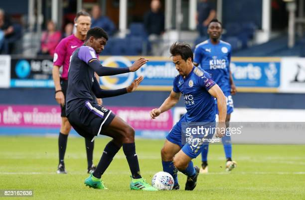 Shinji Okazaki of Leicester City in action with Tyreeq Bakinson of Luton Town during the pre season friendly between Luton Town and Leicester City on...
