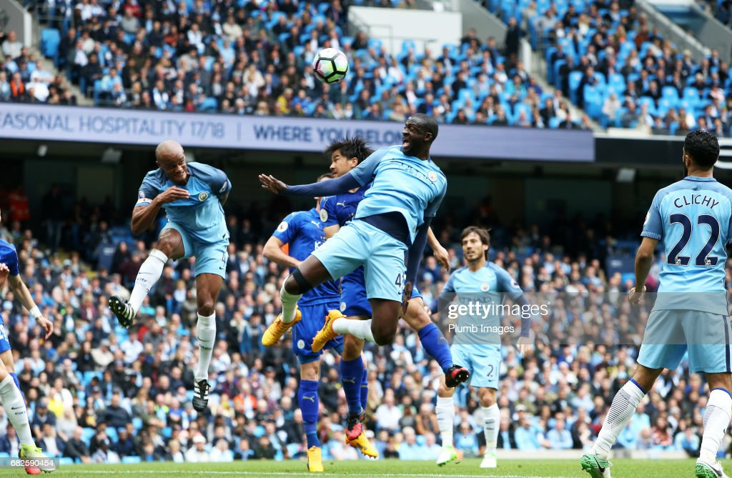 Shinji Okazaki of Leicester City in action with Yaya Toure of Manchester City during the Premier League match between Manchester City and Leicester City at Etihad Stadium on May 13 , 2017 in Manchester, United Kingdom.