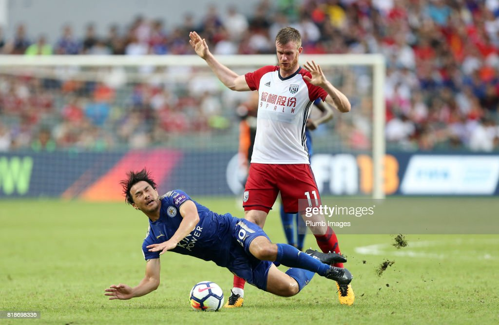 Shinji Okazaki of Leicester City is brought down by Chris Brunt of West Bromwich Albion during the Premier League Asia Trophy on July 19th , 2017 in So Kon Po, Hong Kong.