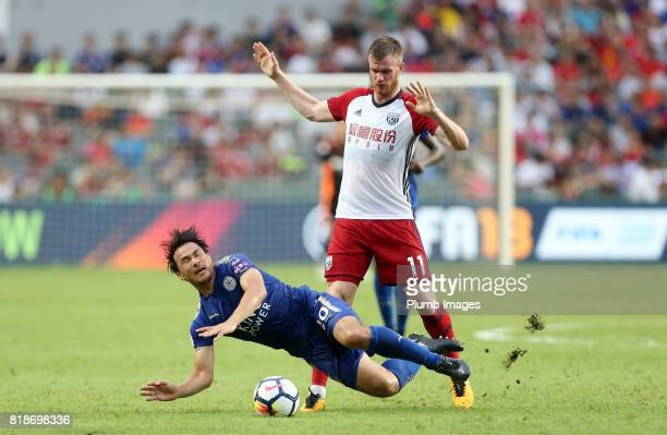 Shinji Okazaki of Leicester City is brought down by Chris Brunt of West Bromwich Albion during the Premier League Asia Trophy on July 19th 2017 in So...