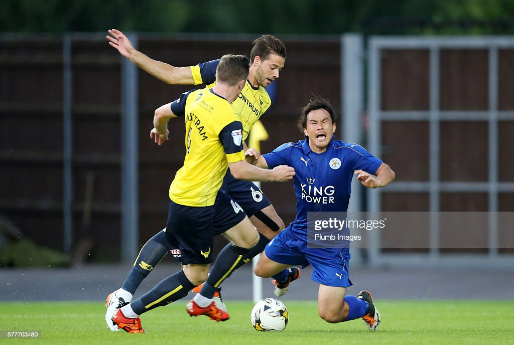Shinji Okazaki of Leicester City is brought down by John Lundstram and Aaron Martin of Oxford United during the pre season friendly between Oxford United and Leicester City at Kassam Stadium on July 19 , 2016 in Oxford, United Kingdom.