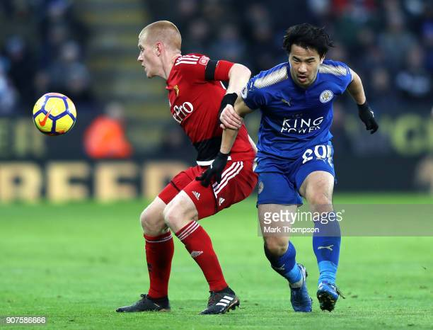 Shinji Okazaki of Leicester City is challenged by Ben Watson of Watford during the Premier League match between Leicester City and Watford at The...
