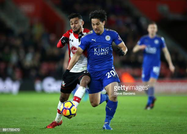 Shinji Okazaki of Leicester City is challenged by Sofiane Boufal of Southampton during the Premier League match between Southampton and Leicester...