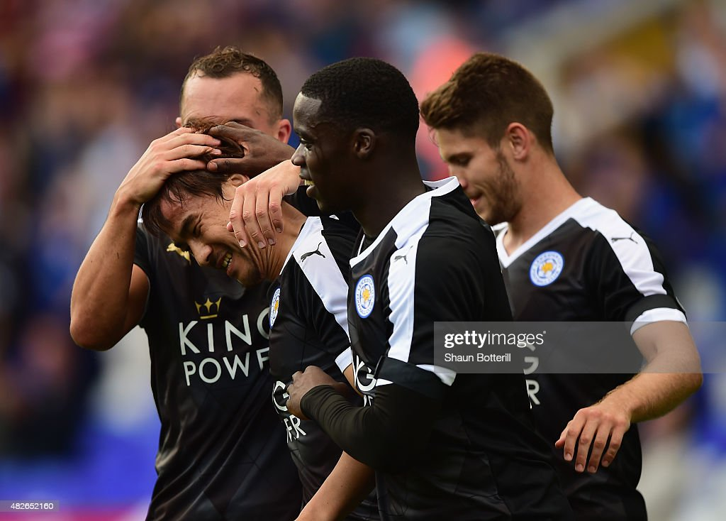 Shinji Okazaki of Leicester City is congratulated by team-mates after scoring during the Pre-Season Friendly match between Birmingham City and Leicester City at St Andrews (stadium) on August 1, 2015 in Birmingham, England.