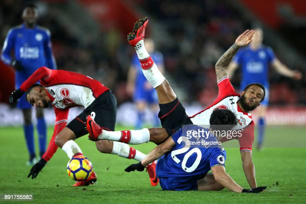 Shinji Okazaki of Leicester City is fouled by Ryan Bertrand of Southampton and Sofiane Boufal of Southampton during the Premier League match between...