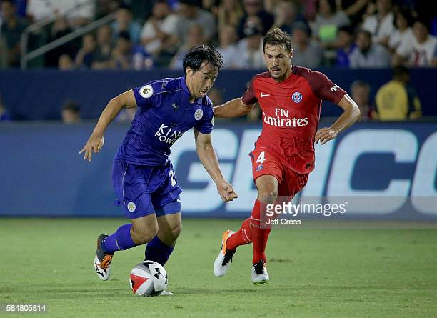 Shinji Okazaki of Leicester City is pursued by Benjamin Stambouli of Paris SaintGermain in the first half during the 2016 International Champions Cup...