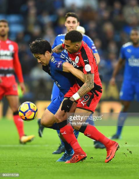 Shinji Okazaki of Leicester City is tackled by Danny Williams of Huddersfield Town during the Premier League match between Leicester City and...