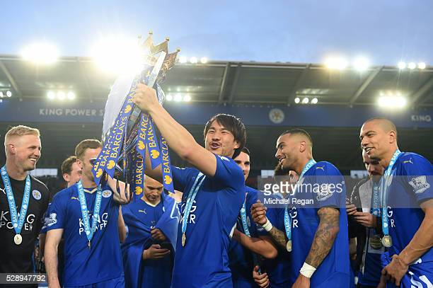 Shinji Okazaki of Leicester City lifts the Premier League Trophy as players and staffs celebrate the season champion after the Barclays Premier...