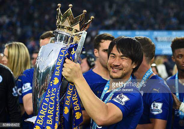 Shinji Okazaki of Leicester City lifts the Premier League Trophy after the Barclays Premier League match between Leicester City and Everton at The...