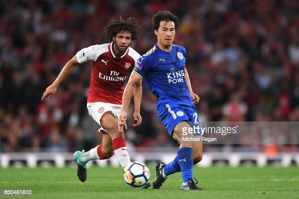 Shinji Okazaki of Leicester City passes the ball during the Premier League match between Arsenal and Leicester City at the Emirates Stadium on August...