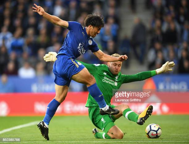 Shinji Okazaki of Leicester City puts the ball past Simon Mignolet of Liverpool but the goal is given offside during the Premier League match between...