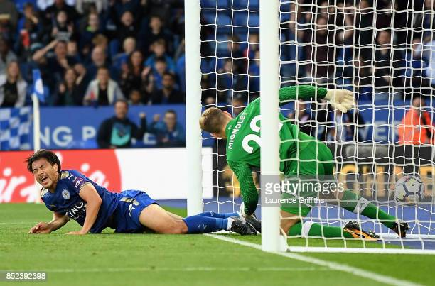 Shinji Okazaki of Leicester City reacts after scoring his sides first goal during the Premier League match between Leicester City and Liverpool at...