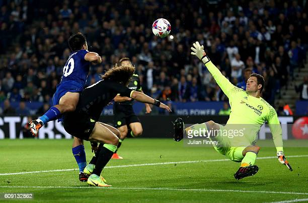 Shinji Okazaki of Leicester City scores his and his sides second goal past Asmir Begovic of Chelsea during the EFL Cup Third Round match between...