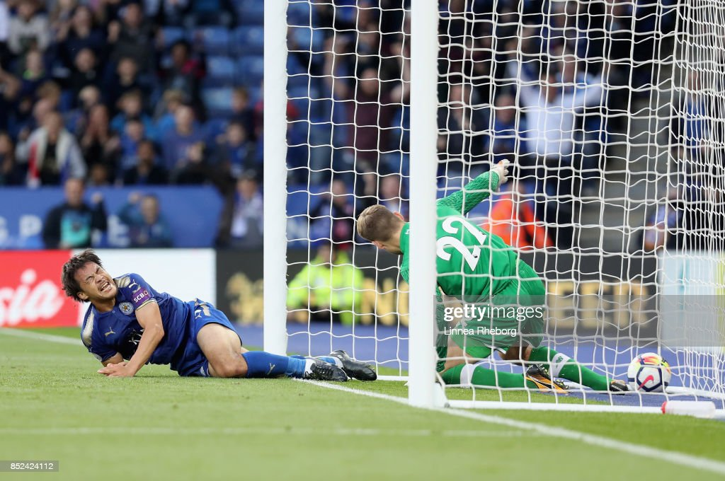 Shinji Okazaki of Leicester City scores his sides first goal past Simon Mignolet of Liverpool during the Premier League match between Leicester City and Liverpool at The King Power Stadium on September 23, 2017 in Leicester, England.