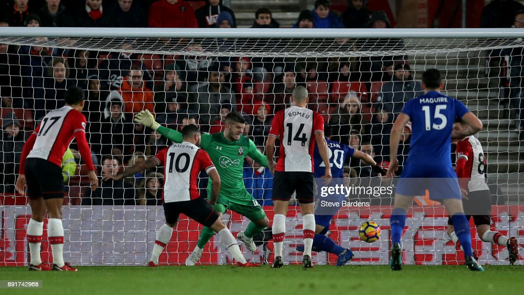 Shinji Okazaki of Leicester City scores his sides second goal past Fraser Forster of Southampton during the Premier League match between Southampton and Leicester City at St Mary's Stadium on December 13, 2017 in Southampton, England.
