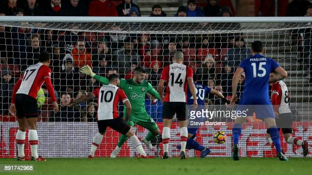 Shinji Okazaki of Leicester City scores his sides second goal past Fraser Forster of Southampton during the Premier League match between Southampton...