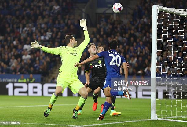 Shinji Okazaki of Leicester City scores the opening goal past Asmir Begovic of Chelsea during the EFL Cup Third Round match between Leicester City...