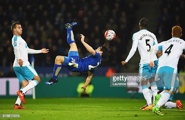 Shinji Okazaki of Leicester City scores their first goal with an overhead kick during the Barclays Premier League match between Leicester City and...
