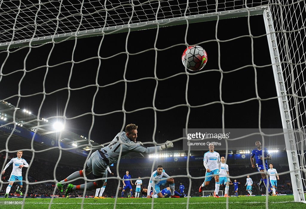 Shinji Okazaki of Leicester City scores their first goal with an overhead kick past goalkeeper Robert Elliot of Newcastle United during the Barclays Premier League match between Leicester City and Newcastle United at The King Power Stadium on March 14, 2016 in Leicester, England.