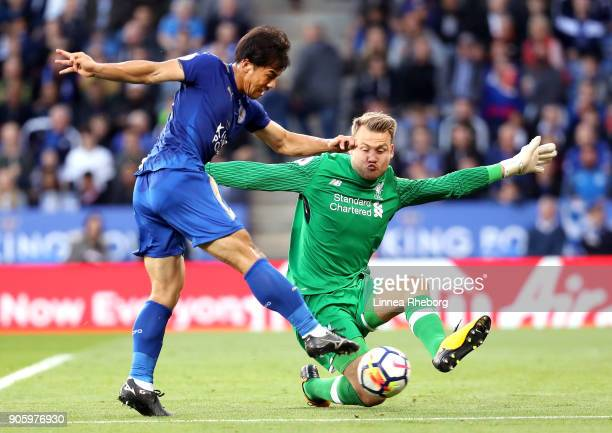 Shinji Okazaki of Leicester City shoots on goal past Simon Mignolet of Liverpool during the Premier League match between Leicester City and Liverpool...