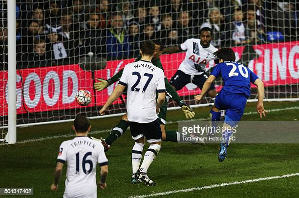 Shinji Okazaki of Leicester City shoots past goalkeeper Michel Vorm of Tottenham Hotspur to score their second goal during the Emirates FA Cup third...