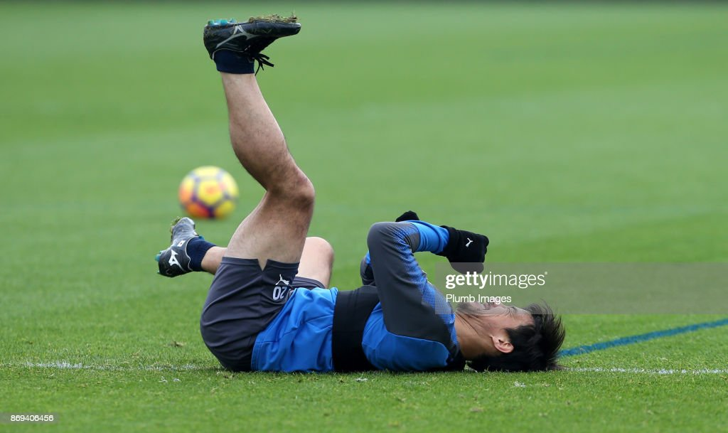 Shinji Okazaki of Leicester City takes a tumble during the Leicester City training session at Belvoir Drive Training Complex on November 02 , 2017 in Leicester, United Kingdom.