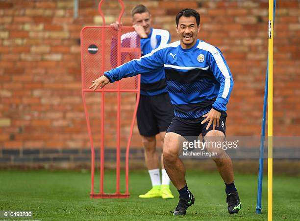 Shinji Okazaki of Leicester City warms up during a Leicester City training session ahead of their Champions League match against FC Porto at Belvoir...