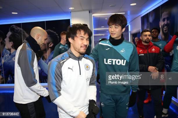 Shinji Okazaki of Leicester City with Ki Sung Yeung of Swansea City ahead of the Premier League match between Leicester City and Swansea City at King...