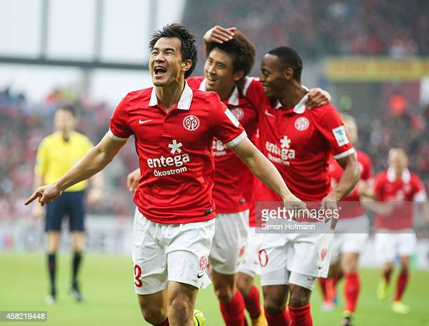 Shinji Okazaki of Mainz celebrates his team's first goal during the Bundesliga match between 1 FSV Mainz 05 and SV Werder Bremen at Coface Arena on...