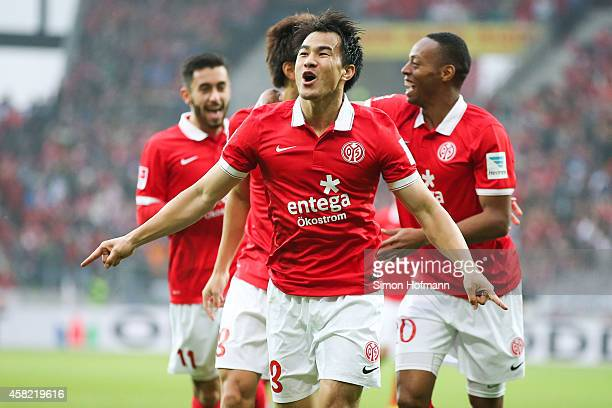 Shinji Okazaki of Mainz celebrates his team's first goal during the Bundesliga match between 1. FSV Mainz 05 and SV Werder Bremen at Coface Arena on...