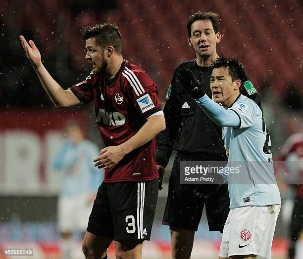 Shinji Okazaki of Mainz gestures to Per Nilsson of Nuernberg during the Bundesliga match between FC Nuernberg and 1 FSV Mainz at Easy Credit Stadium...