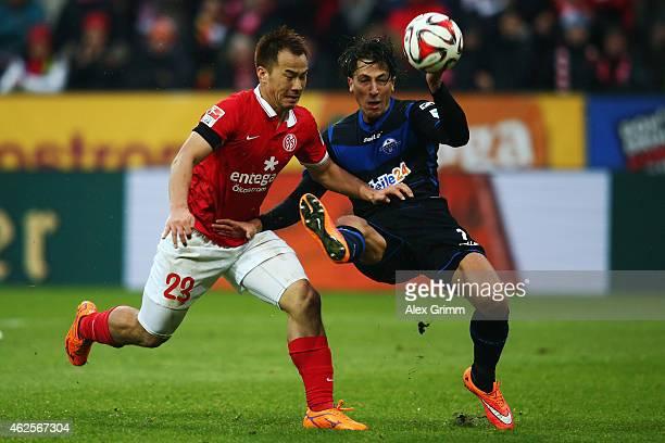 Shinji Okazaki of Mainz is challenged by Jens Wemmer of Paderborn during the Bundesliga match between 1 FSV Mainz 05 and SC Paderborn at Coface Arena...