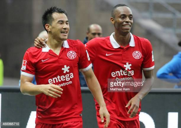 Shinji Okazaki of Mainz jubilates with team mate Junior Diaz after scoring the fourth goal during the Bundesliga match between Hertha BSC and 1FSV...