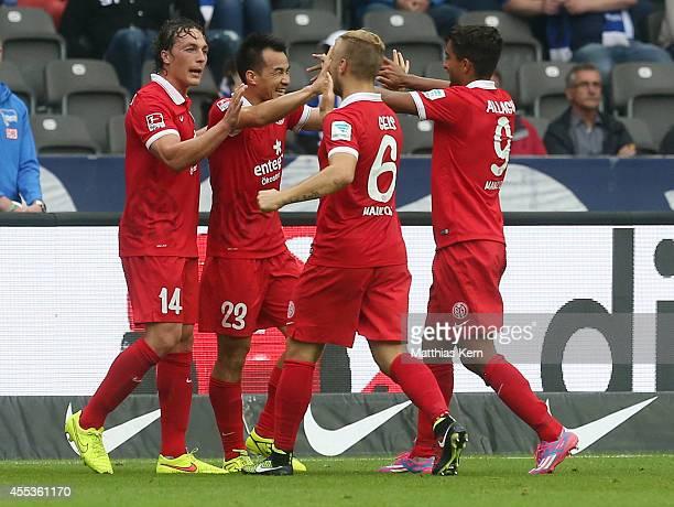 Shinji Okazaki of Mainz jubilates with team mates after scoring the first goal during the Bundesliga match between Hertha BSC and 1FSV Mainz 05 at...