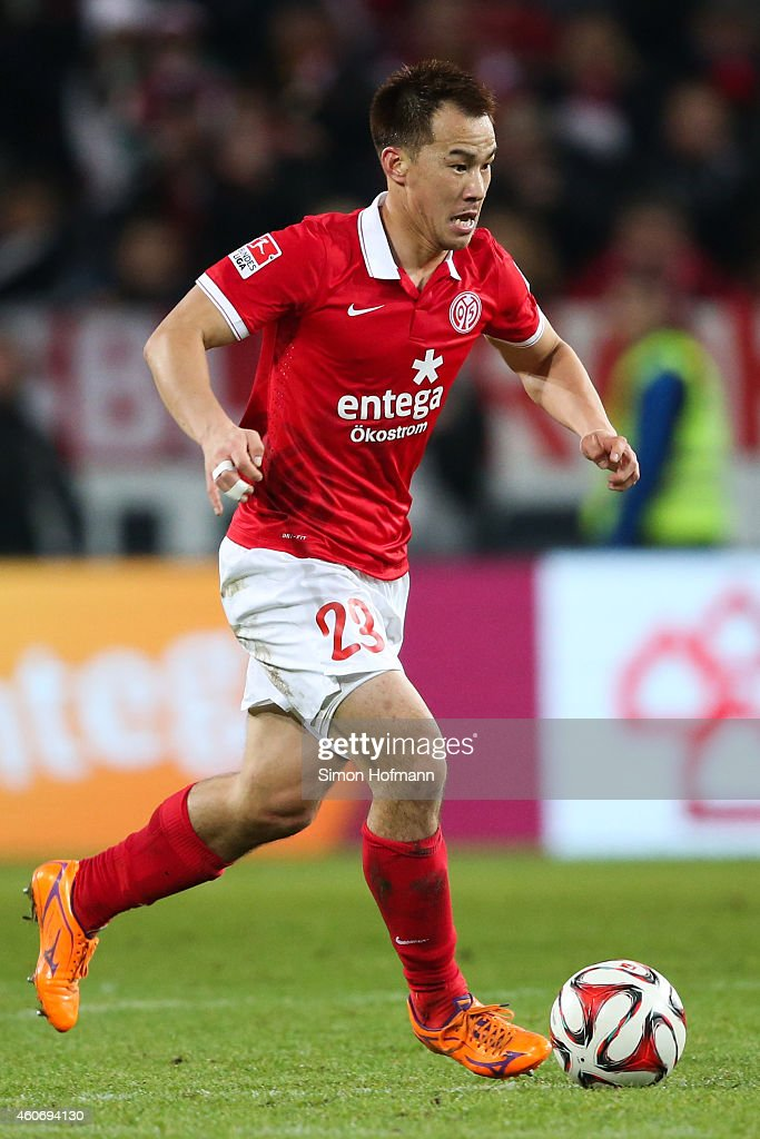 Shinji Okazaki of Mainz runs with the ball during the Bundesliga match between 1. FSV Mainz 05 and FC Bayern Muenchen at Coface Arena on December 19, 2014 in Mainz, Germany.