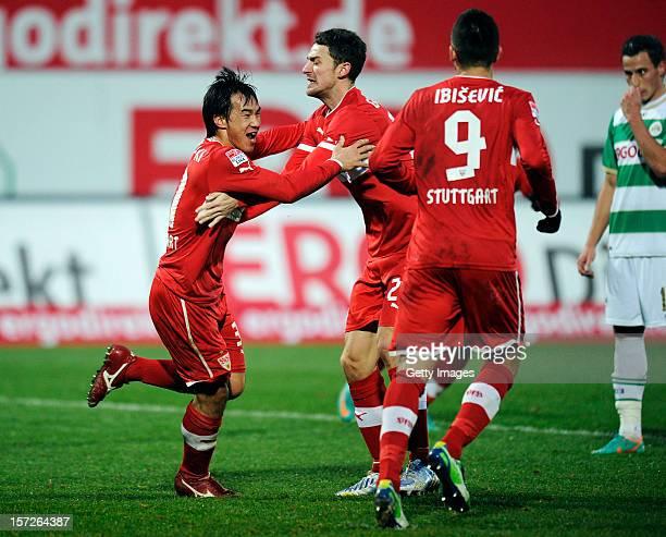 Shinji Okazaki of Stuttgart celebrates his team's first goal with team mates Christian Gentner and Vedad Ibisevic during the Bundesliga match between...