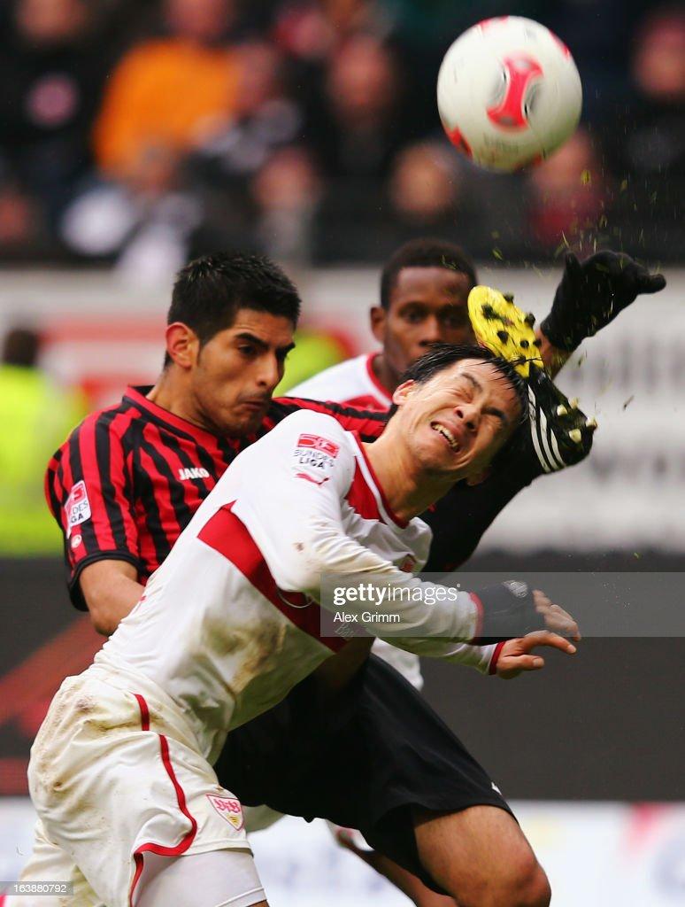 Shinji Okazaki (front) of Stuttgart is challenged by Carlos Zambrano of Frankfurt during the Bundesliga match between Eintracht Frankfurt and VfB Stuttgart at Commerzbank-Arena on March 17, 2013 in Frankfurt am Main, Germany.