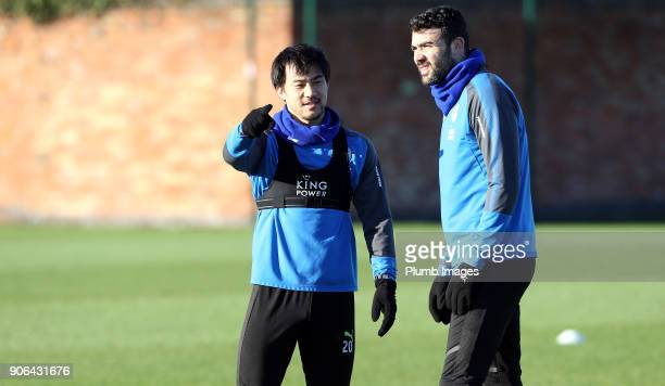 Shinji Okazaki talks to Vicente Iborra during the Leicester City training session at Belvoir Drive Training Complex on January 18 2018 in Leicester...