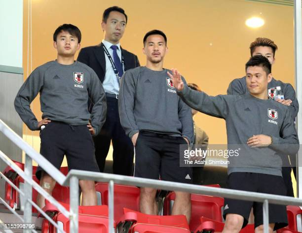 Shinji Okazaki Yuta Nakayama Takefusa Kubo and Eiji Kawashima of Japan are seen in the stand during the international friendly match between Japan...