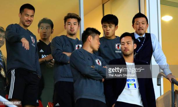Shinji Okazaki Yuta Nakayama Takefusa Kubo Eiji Kawashima and Maya Yoshida of Japan are seen in the stand during the international friendly match...