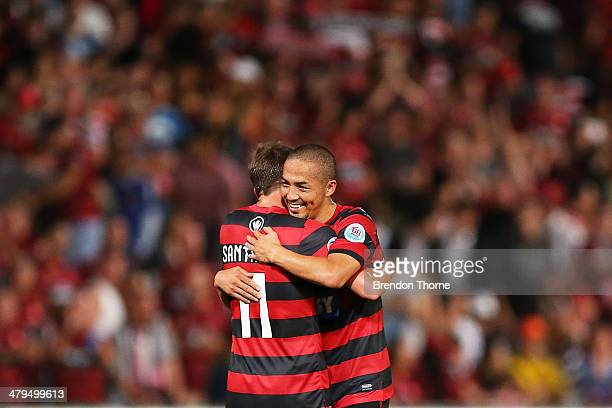 Shinji Ono and Brendon Santalab of the Wanderers celebrate at full time following the AFC Asian Champions League match between the Western Sydney...