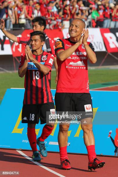 Shinji Ono and Chanathip Songkrasin of Consadole Sappporo applaud supporters after their 10 victory in the JLeague J1 match between Consadole Sapporo...