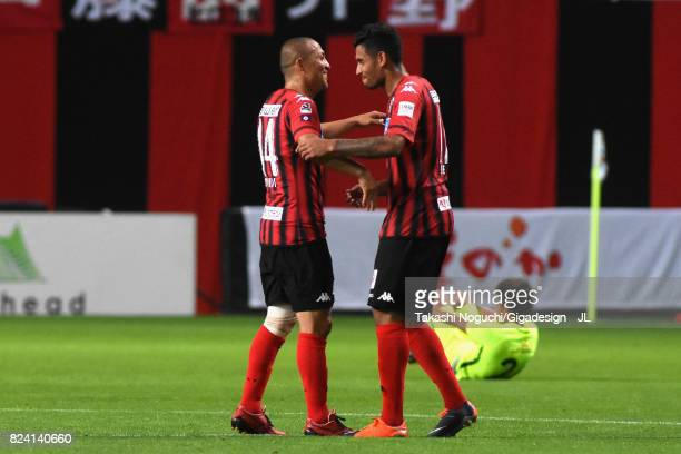 Shinji Ono and Reis of Consadole Sapporo celebrate their 20 victory after the JLeague J1 match between Consadole Sapporo and Urawa Red Diamonds at...