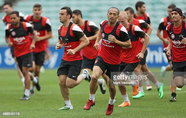 Shinji Ono and Wanderes players warm up during a Western Sydney Wanderers ALeague training session at Pirtek Stadium on April 25 2014 in Sydney...