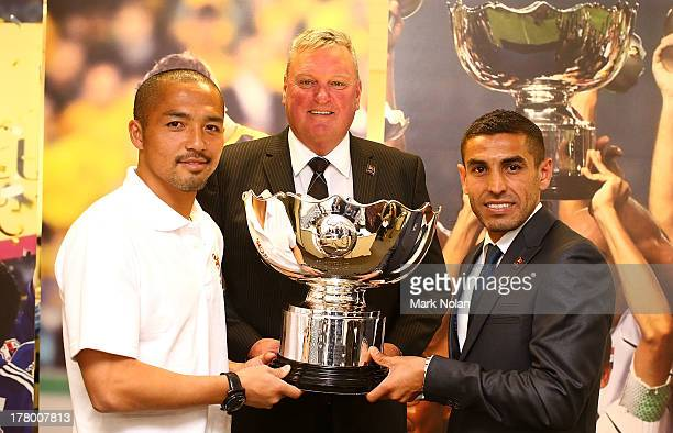Shinji Ono LOC Chief Executive Officer Michael Brown and Ali Abbas pose for a photo with the Asian Cup during the 500 Day to Go announcement ahead of...